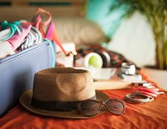 Holiday suitcase, hat and glasses